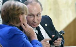 Putin Merkel